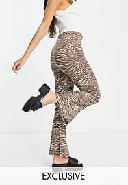 Reclaimed Vintage inspired jersey flares in animal print-Brown