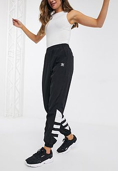 Adidas large trefoil track pants in black