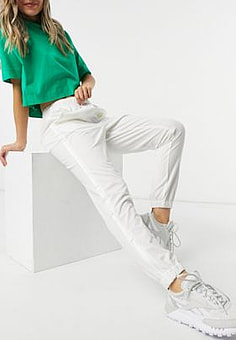 Lacoste sporty logo tracksuit bottoms in white