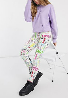 Love Moschino allover multi logo joggers-Black