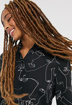Monki Hella recycled polyester face print blouse in black