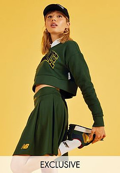 New Balance pleated skirt in green- exclusive to ASOS