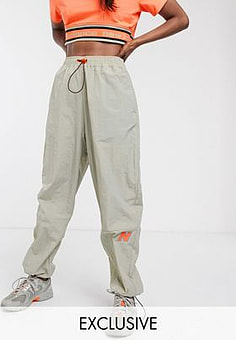 New Balance Utility Pack cargo trousers in beige exclusive at ASOS