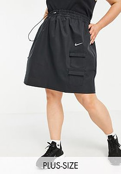 NIKE Swoosh Plus woven skirt in black with utility pockets