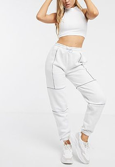 Reebok utility joggers in white with reflective piping exclusive to ASOS-Purple