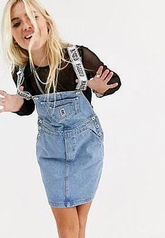The Ragged Priest denim dungaree dress in mid blue