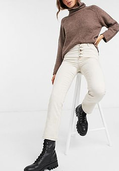 Vero Moda straight leg jeans with button detail and contrast hem in white