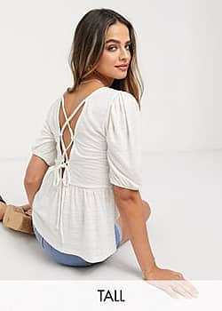 Vero Moda peplum top with lace up back detail in white
